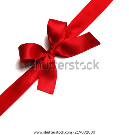 Shiny red satin ribbon decorative on white background - stock photo