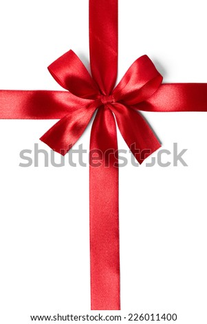 Shiny red satin ribbon on white background. studio shot - stock photo