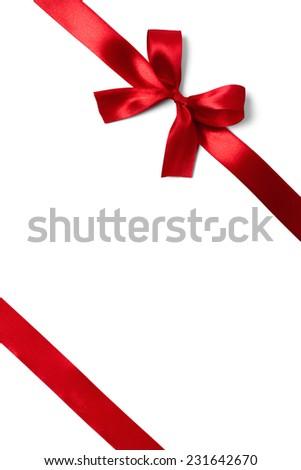 Shiny red satin ribbon on white background. studio shot - stock photo