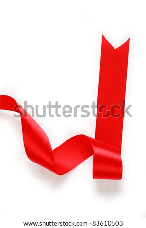 Shiny red satin ribbon on white background with copy space. Macro with extremely shallow dof.