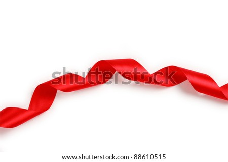 Shiny red satin ribbon on white background with copy space. Macro with extremely shallow dof. - stock photo