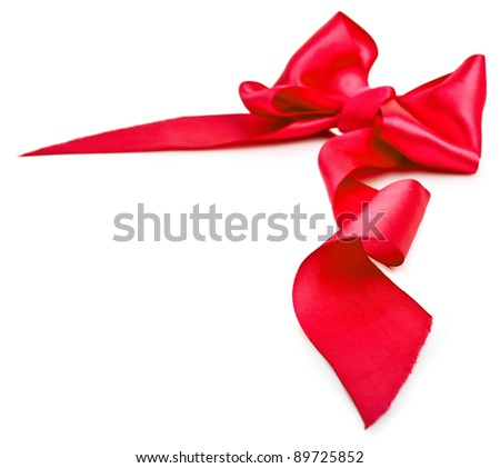 Shiny red satin ribbon on white background with copy space. Macro with extremely shallow dof
