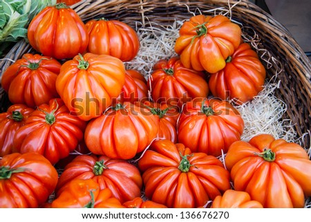 Shiny ripe beefsteak tomatoes at farmers market in Paris. - stock photo
