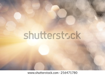 Shiny romantic bokeh. Defocused spots of water drops and lens flare or flash . Glittering wallpaper texture. Bright source of light. Defocused lights. - stock photo