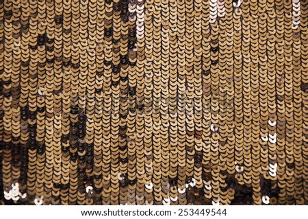Shiny sparkle gold sequins great for texture or background.Glittering sequins wall - stock photo