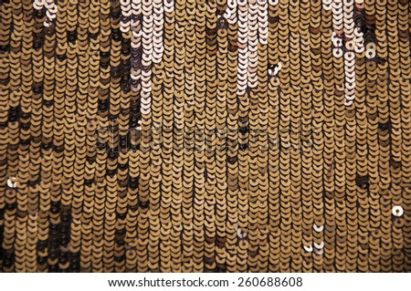 Shiny sparkle gold sequins great for texture or background.Glittering sequins wall