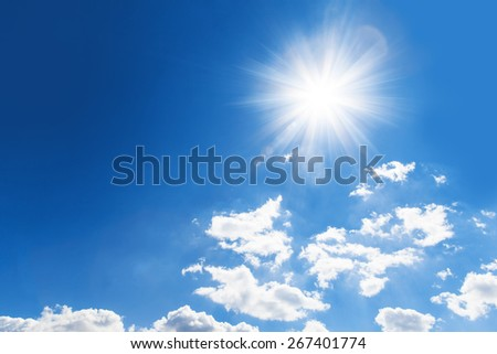 shiny sun against intense cloudy sky - stock photo
