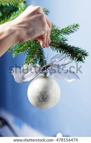 Shiny white decoration hanging on Christmas tree - Close up