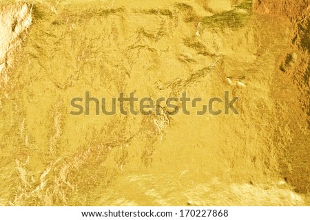Shiny yellow gold foil abstract texture background