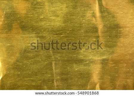 Shiny yellow gold foil texture for background.