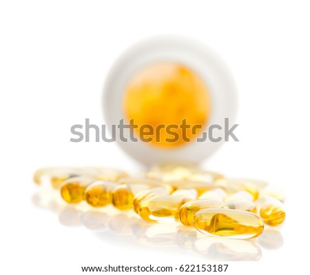 shiny yellow oil capsule spilling out of pill bottle