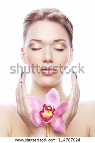 shiny young woman with pink flower on white background