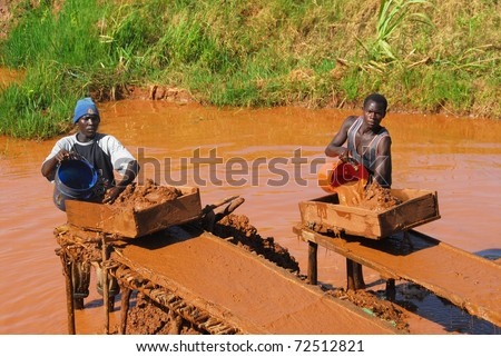 SHINYANGA,TANZANIA CIRCA -MARCH 2010: Gold miners working circa March 18, 2010 in Shinyanga, Tanzania. Tanzania is the third largest gold producer in Africa - stock photo