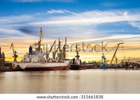 Ship at sunset in shipyard of Gdansk, Poland. - stock photo