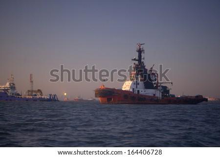 Ship at the harbor of Mumbai, India at sunset - stock photo