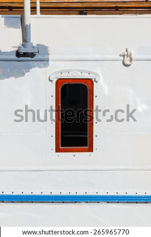 Ship cabin window on a vintage old ship, Sweden - stock photo