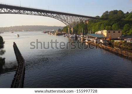 Ship Canal, Seattle, Washington. A large yacht travels leaving Lake Union heading for the Aurora Bridge in the ship canal leading into Puget Sound. Seattle, Washington State, USA. - stock photo