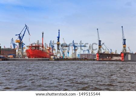 Ship dock at harbor of Hamburg - stock photo