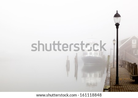 Ship Docked in the Fog. Davis park ferry docked  at Sandspit Marina, Patchogue, Long Island, New York. - stock photo