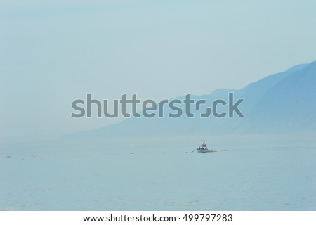 Ship float on foggy sea in Shireitoko, Hokkaido, Japan