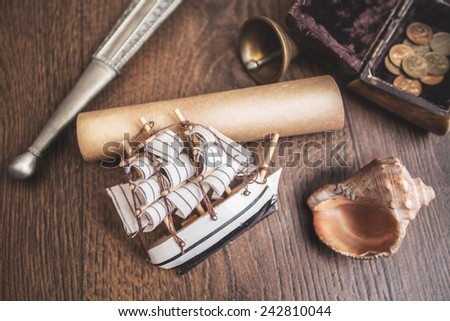 ship frigate parquet scroll coin coinage bell shell sea pirate frame for pictures frame photography memories - stock photo