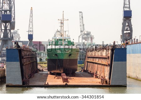 Ship in a dry dock for replairs - stock photo