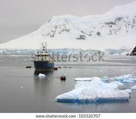 Ship in Antarctic waters beetween snow