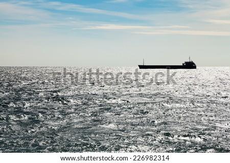 ship in Black sea in autumn evening - stock photo