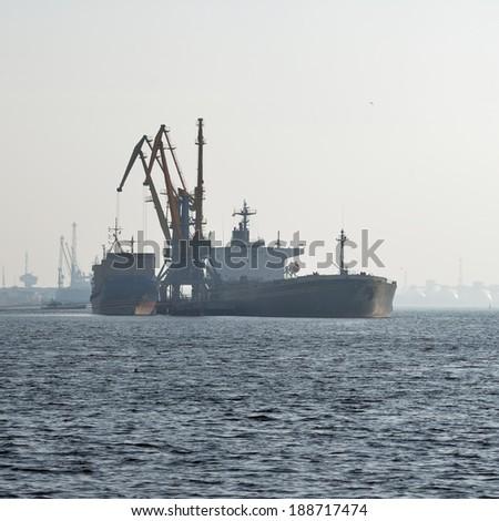 Ship in cargo port coal terminal. Riga terminal, Latvia - stock photo