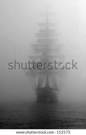 Ship in fog. Black and white photo.