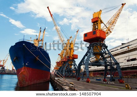 Ship in seaport on loading. Closeup. - stock photo