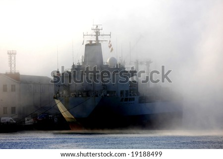 ship in the dock in the misty morning