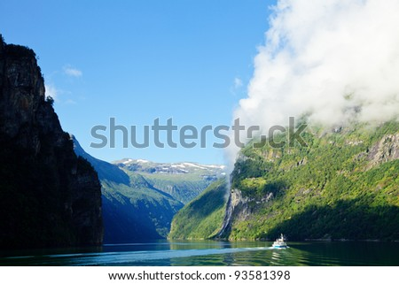 Ship in the Geiranger fjord, listed as a UNESCO World Heritage Site