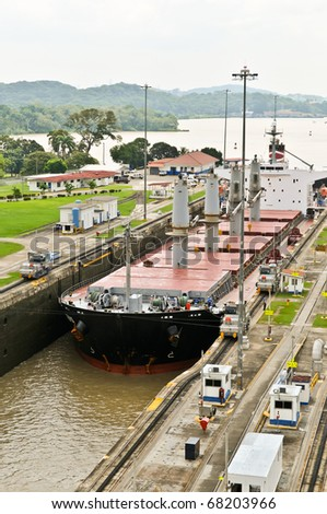 Ship in the Panama Channel Lock centered by locomotives