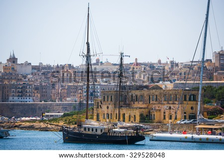 ship in the Valletta port in Malta on the background of the city