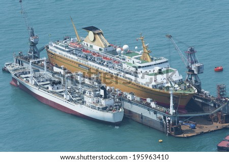 Ship is being renovated in shipyard - stock photo