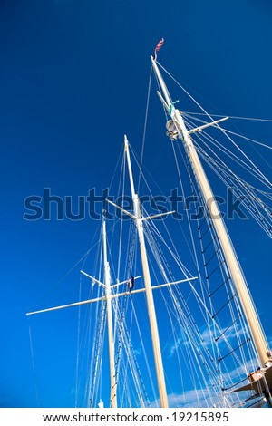 Ship masts against the blue sky 2 - stock photo