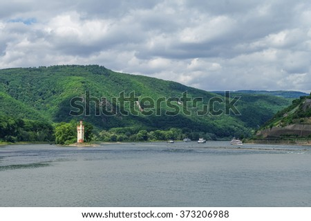 Ship, medieval castle Mouse Tower (M�¤useturm) and vineyards on the slope of Rhine river bank, Bingen am Rhein, Germany - stock photo