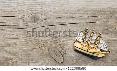 ship model on wood background - stock photo