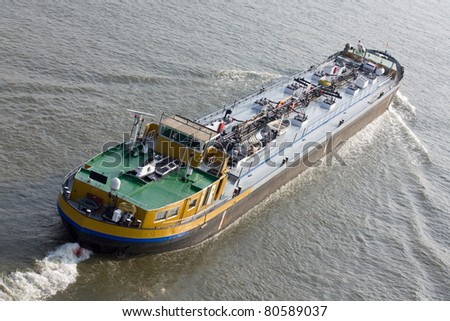 Ship moving to harbor - stock photo