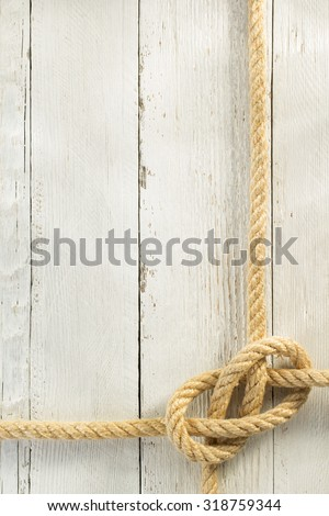 ship rope on wooden background - stock photo