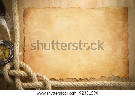ship ropes and compass at parchment old paper background - stock photo