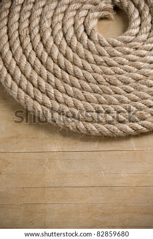 ship ropes and knot on wood background texture