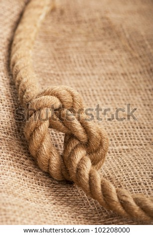 ship ropes on a sacking, a linen fabric background texture - stock photo