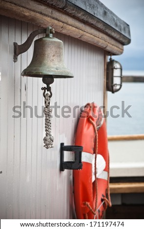 ship's Bell  on an old sailboat - stock photo