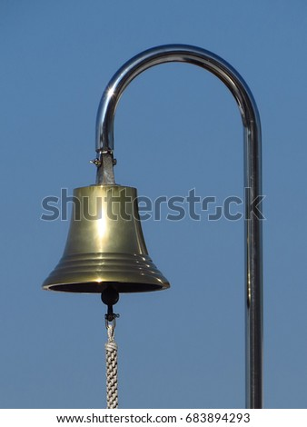 Ship's bell with blue sky background
