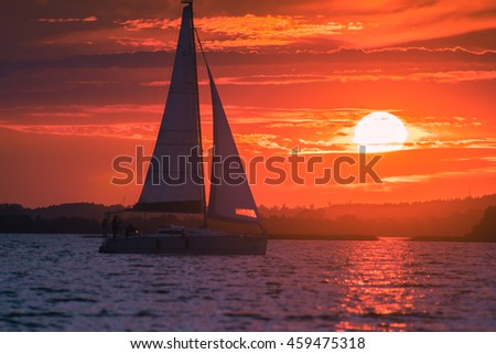 Ship sailing to the Sunset