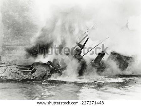 Ship sinking into the ocean - stock photo