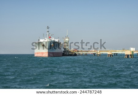 ship tanker lng gas in port blue sky - stock photo