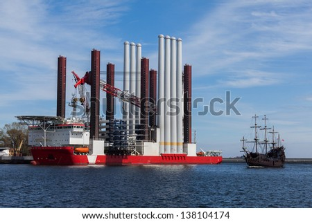 Ship Type: Offshore construction jack up with a cargo. - stock photo